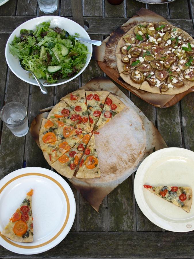 tomato pizza, fig pizza, green salad
