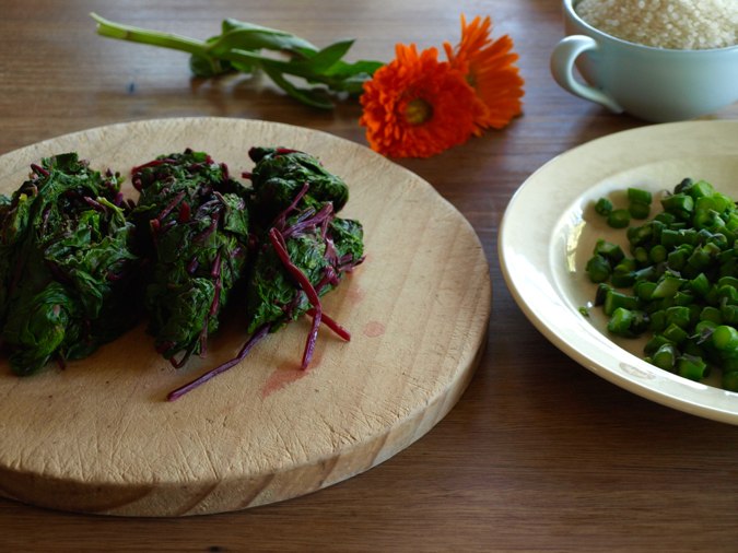 Blanched beetroot leaves, chopped asparagus, calendula and short-grain rice