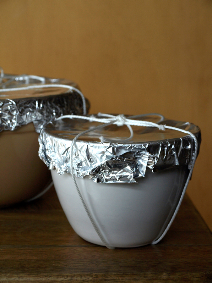 Christmas puddings in bowls for steaming