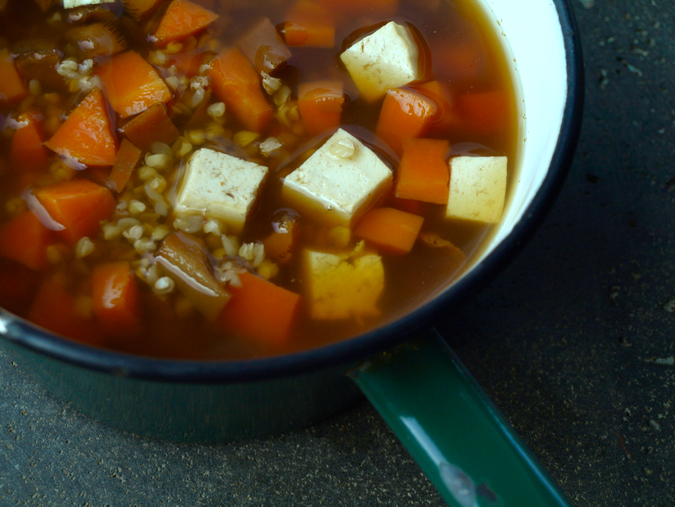 Japanese buckwheat soup with tofu, carrot and mushroom