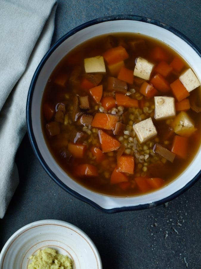 Japanese buckwheat soup with tofu, carrot, mushroom and fresh ginger