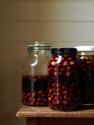 Homemade olives in brine in jars