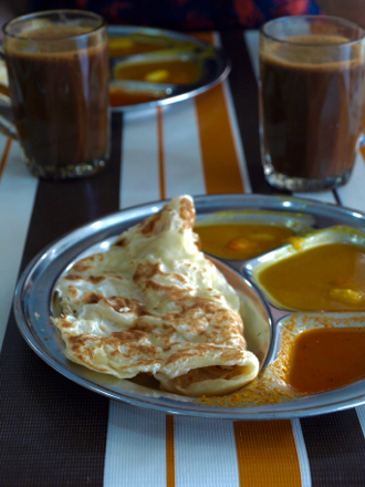Quintessential Malaysian breakfast – roti canai and iced coffee near Setiawangsa, KL
